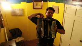 guy not sure what he is doing with his life playing accordion